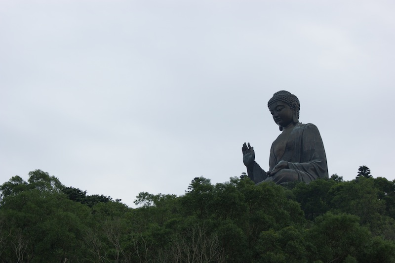 The Tian Tan Buddha floats on the trees