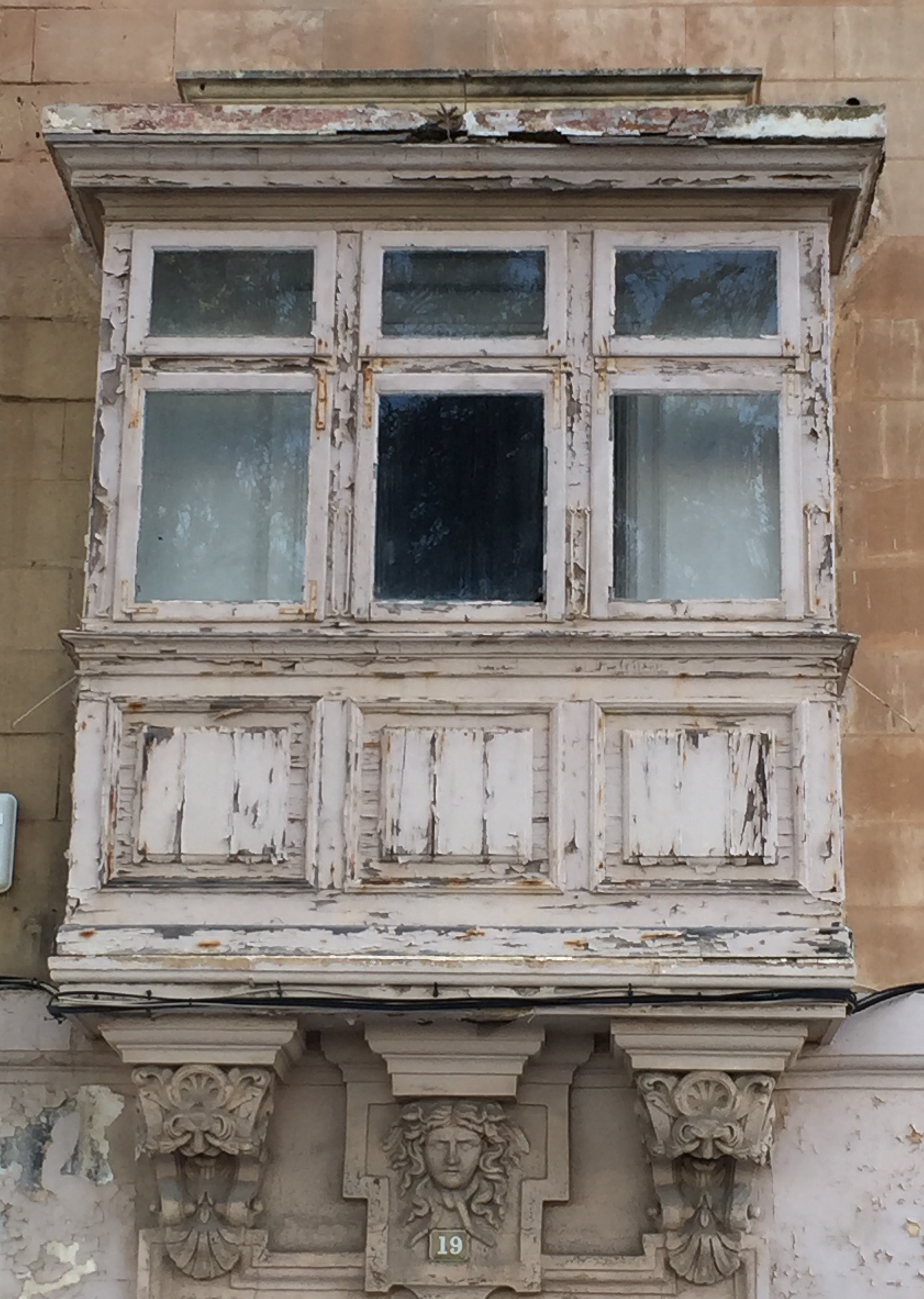 Balconies are a key feature of Maltese buildings